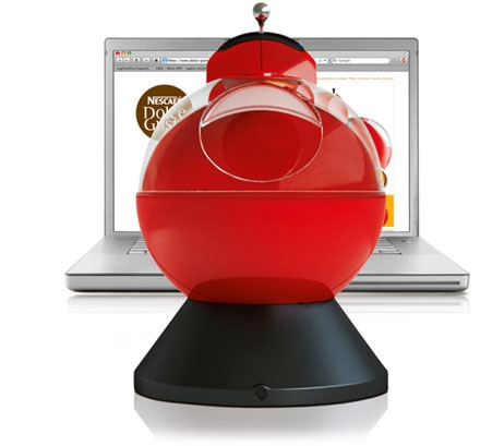 NESCAFÉ® Dolce Gusto® coffee machine and laptop